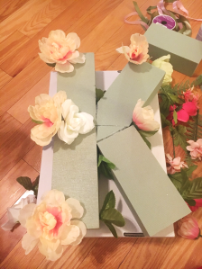 First steps in placing the flowers onto the green floral foam